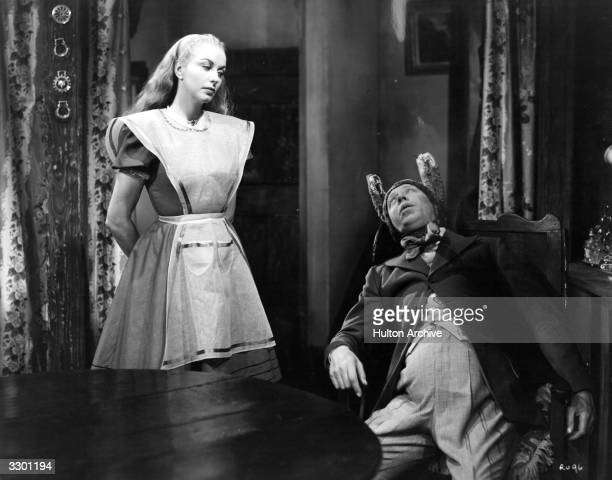 British comedian George Formby and Rosalyn Boulter star in the Columbia comedy 'George In Civvy Street' which echoes 'Alice In Wonderland' The film...