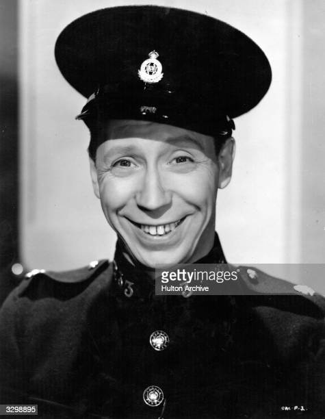British comedian George Formby formerly George Booth plays a member of the Police War Reserve in the Ealing comedy 'Spare A Copper' directed by John...