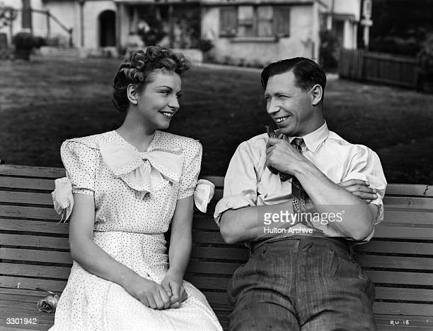 British comedian George Formby stars with Rosalyn Boulter in the Columbia comedy 'George In Civvy Street' directed by Marcel Varnel