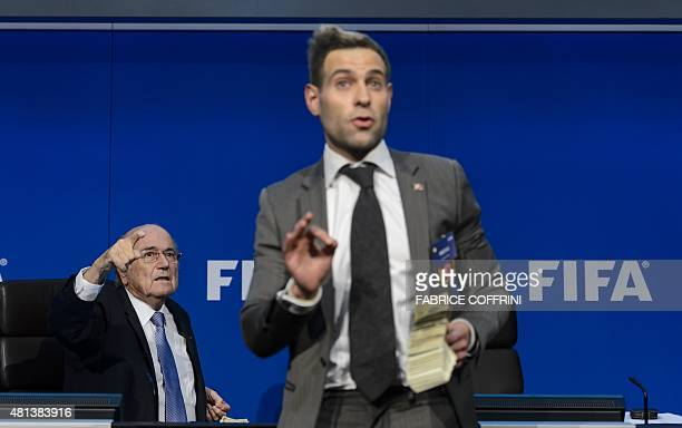 British comedian Lee Nelson gestures in front of FIFA president Sepp Blatter during a press conference at the football's world body headquarter's on...