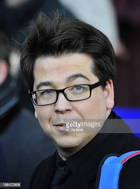 British comedian Michael McIntyre attends Tottenham Hotspur's English Premier League football match against Swansea City at White Hart Lane in...