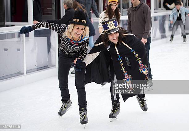"""British comedian Noel Fielding and Radio DJ Lliana Bird take part in a """"Hats Off to Isabella Blow!"""" event on the ice rink at Somerset House in..."""
