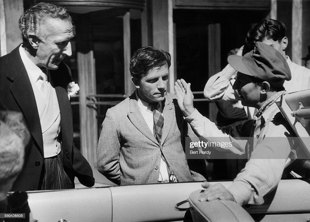 British comedian Norman Wisdom (centre) on the set of his debut film 'Trouble In Store', with supporting actor Jerry Desmonde (1908 - 1967, left) and director, John Paddy Carstairs (1910 - 1970), Pinewood Studios, Buckinghamshire, January 1954. Original Publication: Picture Post - 6887 - Will Norman Wisdom Be Another Charlie Chaplin - pub 30th January 1954