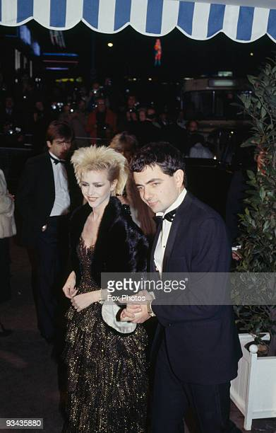 British comedian Rowan Atkinson with his girlfriend actress Leslie Ash at the premiere of the James Bond film 'Never Say Never Again' 1983