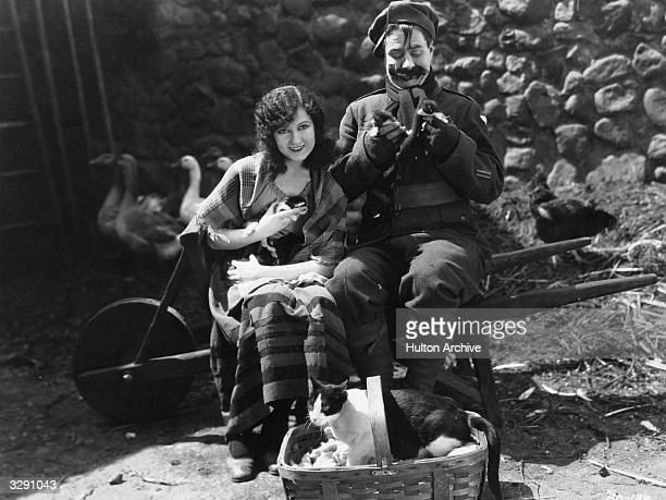 British comedian Syd Chaplin actress Doris Hill and a large cat star in the silent comedy 'The Better 'Ole' set during World War I The film was...