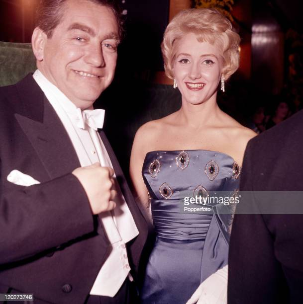 British comedian Tony Hancock with actress Liz Fraser at the premiere of The Guns of Navarone at the Odeon Theatre London on 27th April 1961