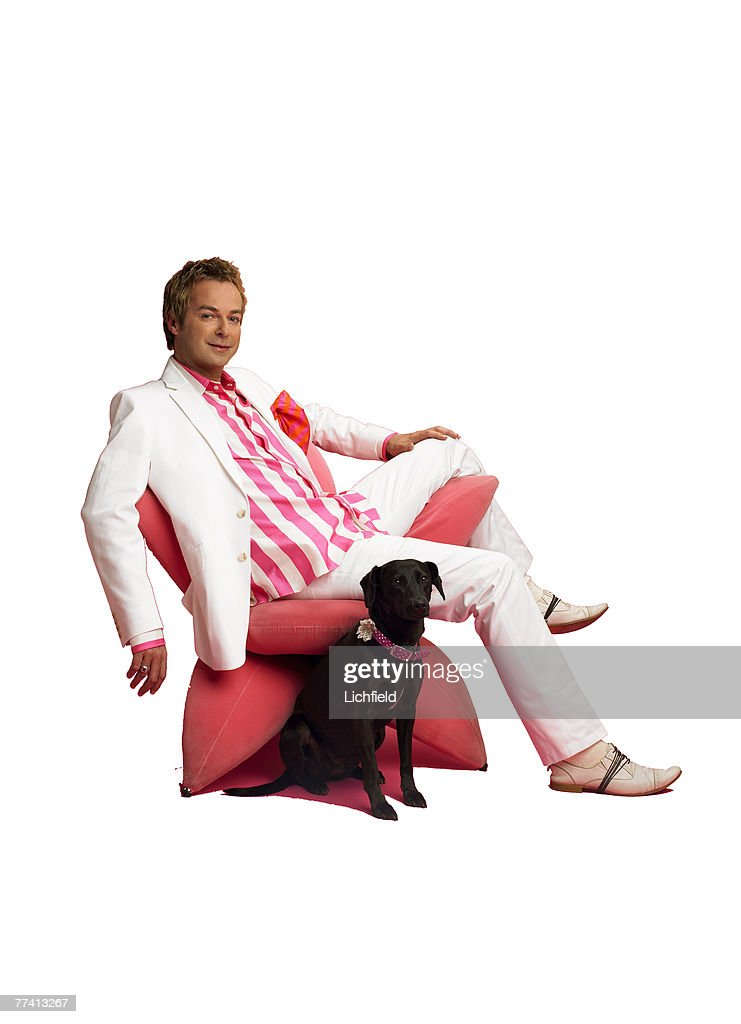 British comedian, writer and television presenter Julian Clary with his pet dog Valerie, named in tribute to Valerie Singleton, whom he greatly admires on 11th May 2005. (Photo by Lichfield/Getty Images).