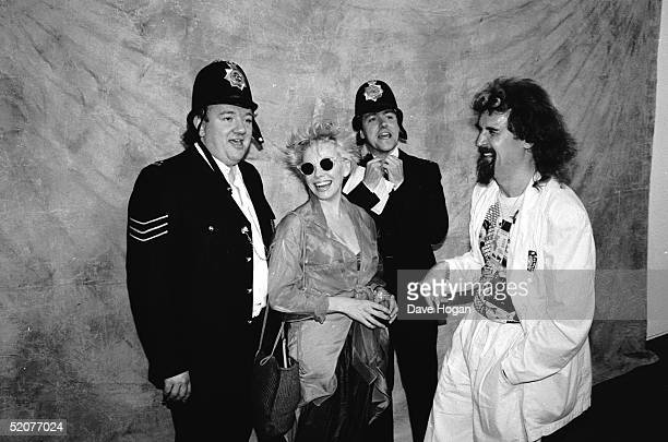 British comedians Mel Smith and Gryff Rhys Jones with Scottish comedian Billy Connolly and his wife New Zealand born actress and comedienne Pamela...