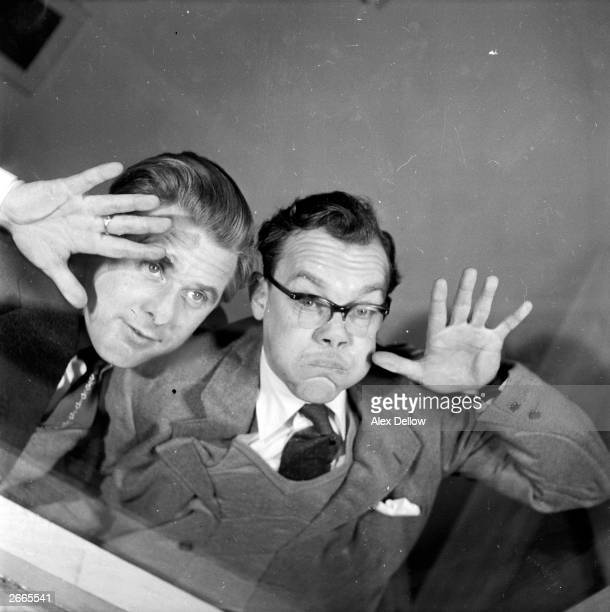 British comedians of stage and screen Eric Morecambe and Ernie Wise pulling faces Original Publication Picture Post 6849 The Queen's Champions pub...