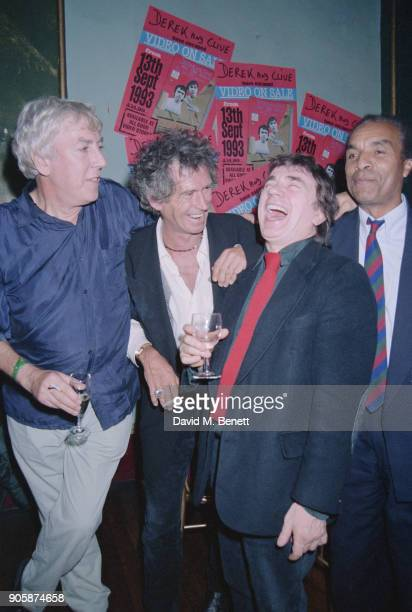 British comedians Peter Cook and Dudley Moore with guitarist Keith Richards and singersongwriter Kenny Lynch at the release party for the uncut...