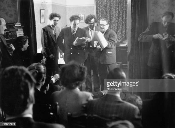 British comedy act The Goons performing at a press call Left to right Spike Milligan Peter Sellers Michael Bentine and Harry Secombe