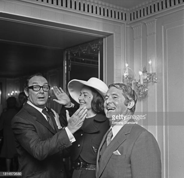 British comedy duo Eric Morecambe and Ernie Wise with actress Margaret Lockwood at a Foyle's Luncheon in London, UK, 25th September 1973.