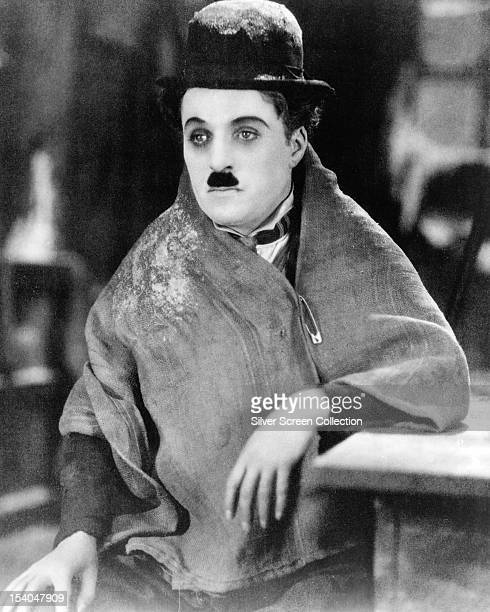 British comic actor and director Charlie Chaplin as the Little Tramp in a publicity still for the silent comedy 'The Gold Rush' directed by Chaplin...