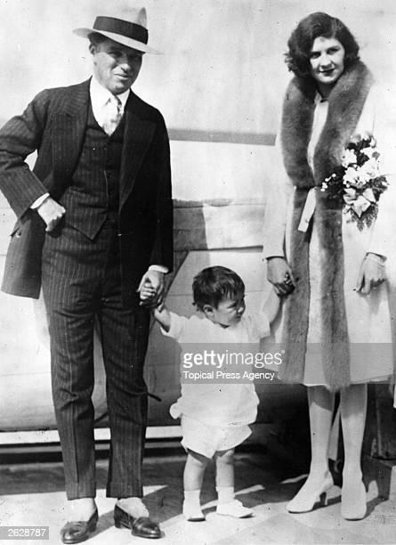 British comic actor and film director Charlie Chaplin with his second wife Lita Grey and their son Charles Jnr on board the SS City of Los Angeles...