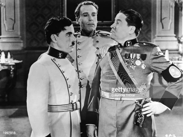 British comic actor Charlie Chaplin with Jack Oakie and an unidentified man in a scene from the film 'The Great Dictator' directed by chaplin 1940