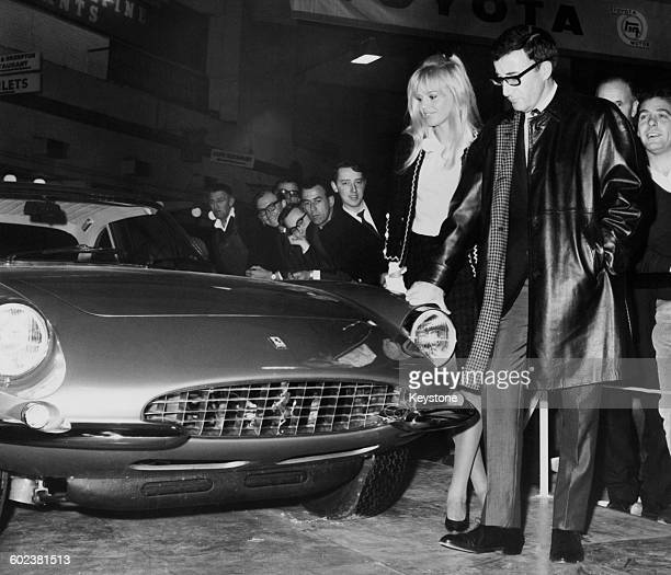 British comic actor Peter Sellers and his wife Swedish actress Britt Ekland inspecting a Ferrari 500 Superfast coupe which Sellers has just bought...