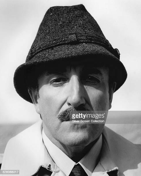 British comic actor Peter Sellers as Chief Inspector Jacques Clouseau in a promotional portrait for one of the five 'Pink Panther' comedies he made...