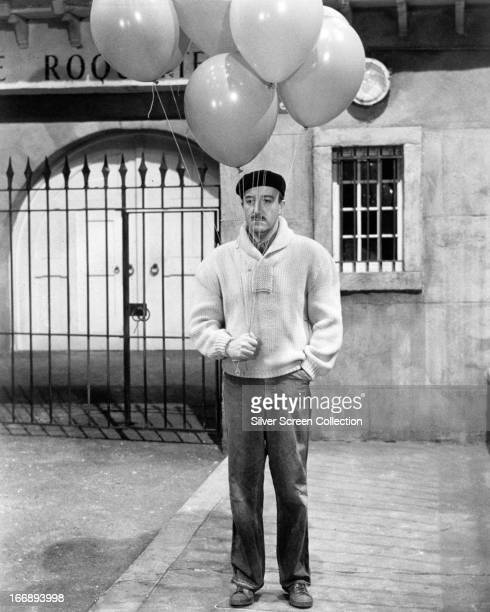 British comic actor Peter Sellers as Inspector Jacques Clouseau disguised as a balloon seller in 'A Shot In The Dark' directed by Blake Edwards 1964