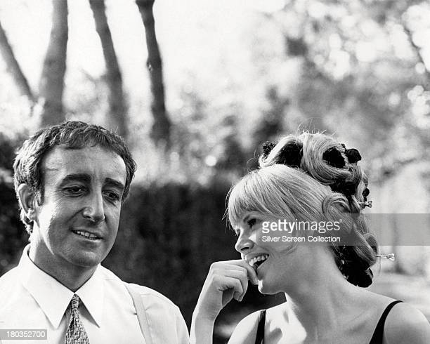 British comic actor Peter Sellers with his wife Swedish actress Britt Ekland on the set of 'The Bobo' directed by Robert Parrish 1967