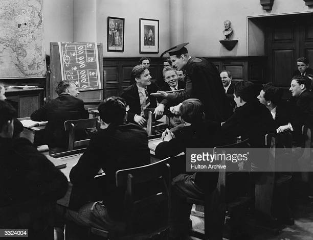 British comic actor Will Hay in a classroom scene from the film 'Good Morning Boys' directed by Marcel Varnel for Gainsborough