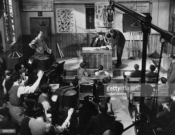 British comic actor Will Hay on the set of the film 'Good Morning Boys' directed by Marcel Varnel and produced by Gainsborough Pictures