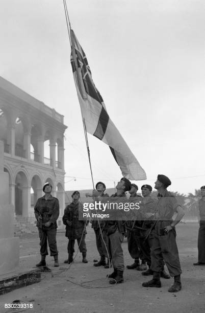 British Commandos raise the White Ensign over Navy House Port Said Egypt ten minutes after capturing the building in heavy fighting with Egyptian...