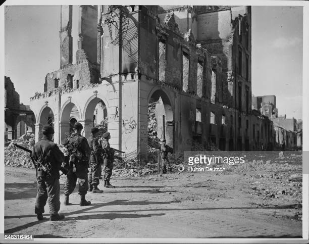 British commandos search ruins for Egyptians and firearms.