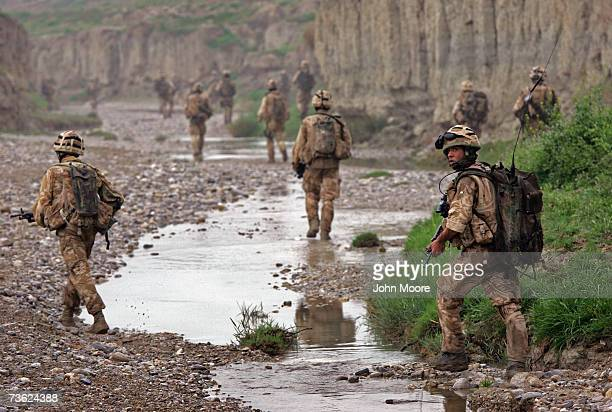British commandos withdraw after a sunrise attack on Taliban positions on March 18, 2007 near Kajaki in the Afghan province of Helmand. Members of...