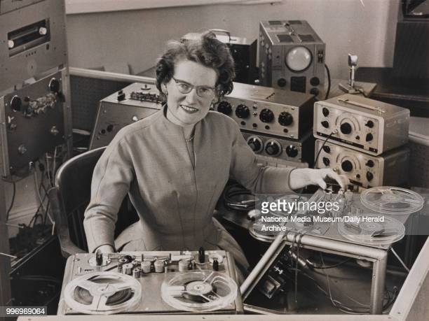 British composer and electronic musician, Daphne Oram in the studio at her home, Tower Folly, a converted oast house, near Wrotham in Kent, 5th...