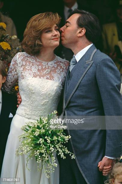 British composer and musical theatre impresario Andrew Lloyd Webber kisses his wife Madeleine Gurdon outside Saint Botolph's Church following their...