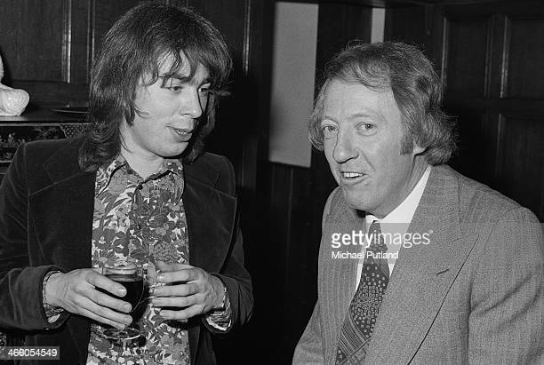 British composer Andrew Lloyd Webber with Australian impresario Robert Stigwood at a party given by Stigwood's RSO Records company London 1974