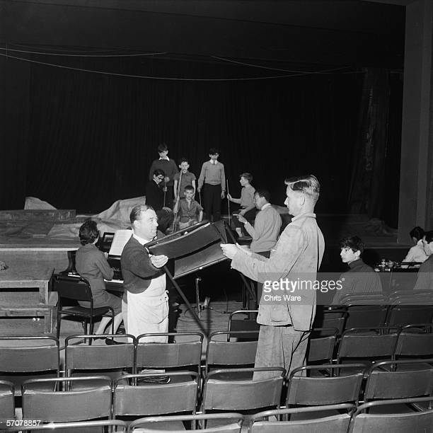 British composer Benjamin Britten takes the cast of his latest opera 'A Midsummer Night's Dream' through a rehearsal only days before the work...