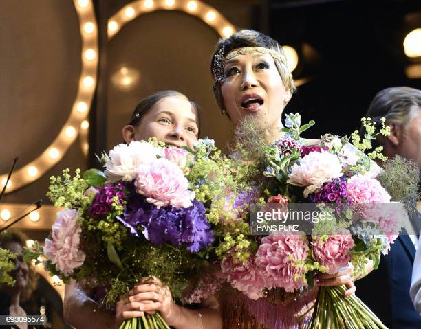 British composer pianist violinist Alma Deutscher and South Korean Soprano Sumi Jo stand on stage after the Life and Celebration Concert 'Recognize...