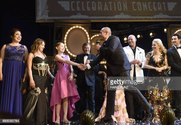 British composer pianist violinist Alma Deutscher Life Ball organizer Gery Keszler and performing artists stand on stage after the Life and...
