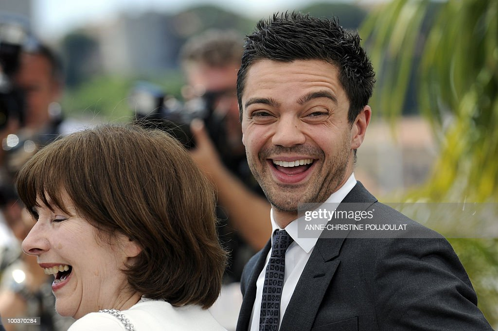 British composer Posy Simmonds and British actor Dominic Cooper pose during the photocall of 'Tamara Drewe' presented out of competition at the 63rd Cannes Film Festival on May 18, 2010 in Cannes.