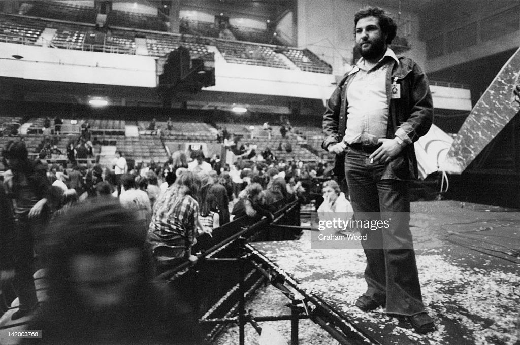 British concert promoter Harvey Goldsmith (right) on the stage after the last night of a series of concerts by the Rolling Stones on their European tour, Earl's Court Arena, London, 27th May 1976.