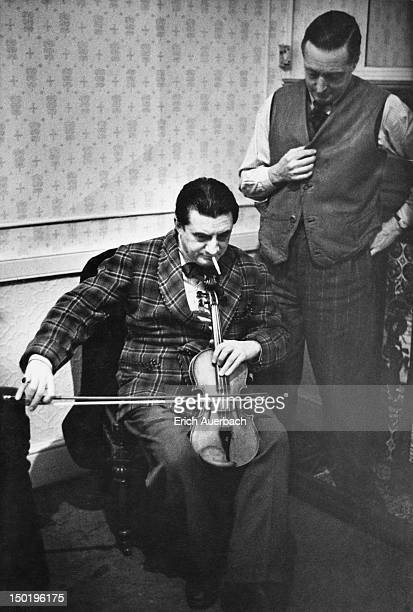 British conductor and cellist Sir John Barbirolli playing a violin as if it were a viol, circa 1949.