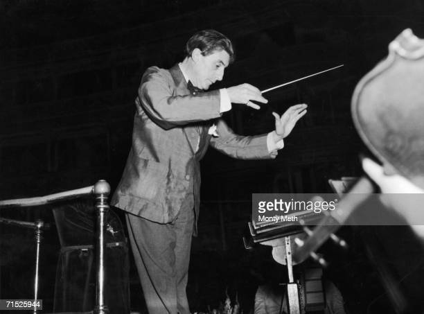 British conductor Sir John Barbirolli conducting the Halle orchestra in rehearsals for a promenade concert at the Royal Albert Hall, 24th August 1953.
