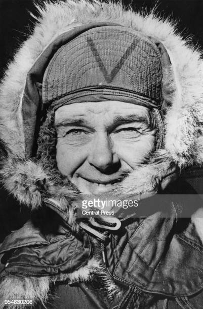 British conservationist Peter Scott the son of polar explorer Robert Falcon Scott tries out Antarctic headgear in Christchurch New Zealand for his...