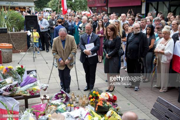 British Conservative MP for Harlow Robert Halfon and Poland's ambassador to the UK Arkady Rzegocki pay their respects ahead of a minute's silence at...