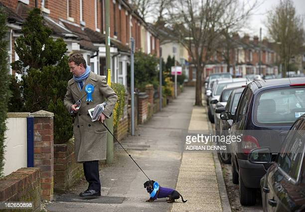 British Conservative MP Gregory Barker and his dog Otto canvas for votes on behalf of his party's candidate for the Eastleigh byelection Maria...