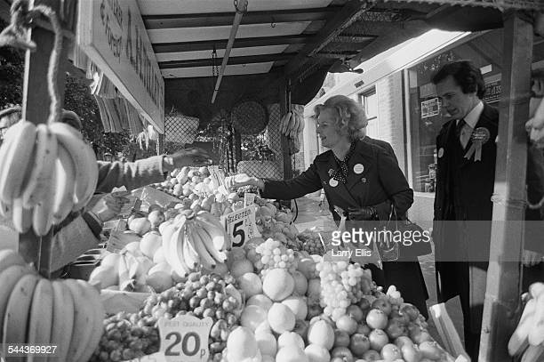British Conservative Party Education Secretary, and MP for Finchley, Margaret Thatcher shopping at a fruit stall during the UK general election...