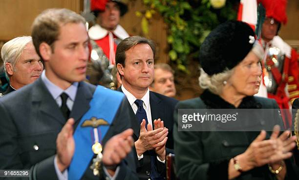 British Conservative party leader David Cameron applauds behind the Duchess of Cornwall Camilla wife of Britain's Prince Charles and Britain's Prince...