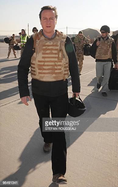 British Conservative Party leader David Cameron boards a helicopter at Kandahar in Afghanistan today to fly to Lashkar Gah in Afghanistan on December...