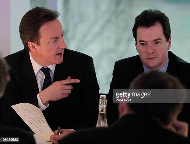 British Conservative party leader David Cameron points to shadow Chancellor of the Exchequer George Osborne as he heads a shadow cabinet meeting on...