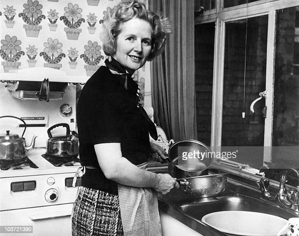 British Conservative Party leader Margaret Thatcher poses in February 1975 in the kitchen of her Chelsea home in London following her 11 February...