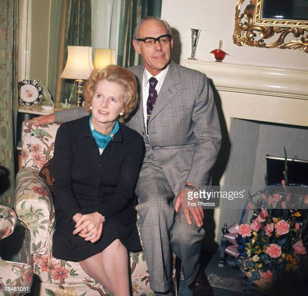 British Conservative Party leader Margaret Thatcher posing with her husband Denis as they celebrate their silver wedding anniversary 13th December...