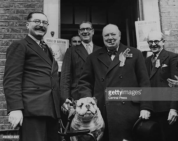 British Conservative Party leader Winston Churchill with a bulldog mascot as he leaves the Wanstead Conservative Club in his Woodford Essex...