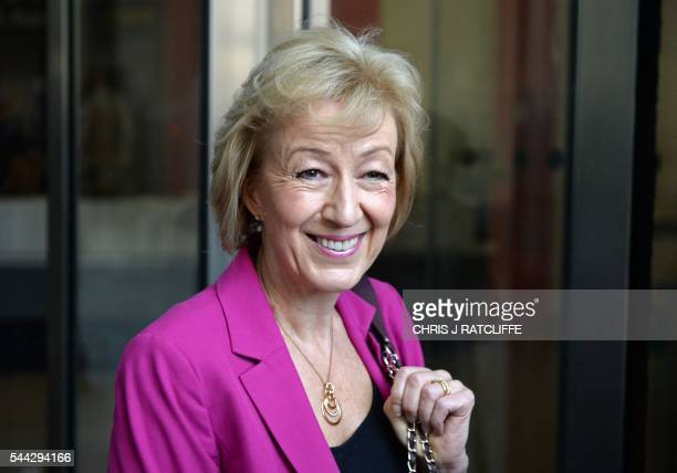 British Conservative party leadership candidate Andrea Leadsom stops to pose for photographers as she arrives at the BBC television centre in London...