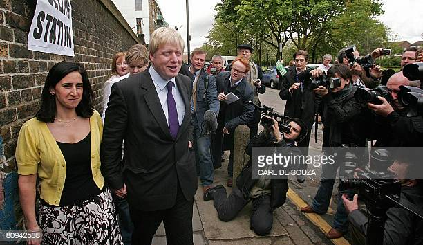 British Conservative Party mayoral candidate Boris Johnson and his wife Marina arrive at a polling station in Highbury and Islington in north London...
